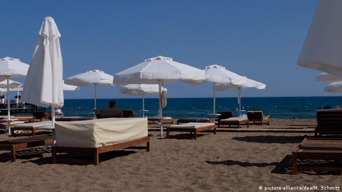 A picture of empty beach chairs lined up on a beach in Turkey's tourism hot spot Antalya