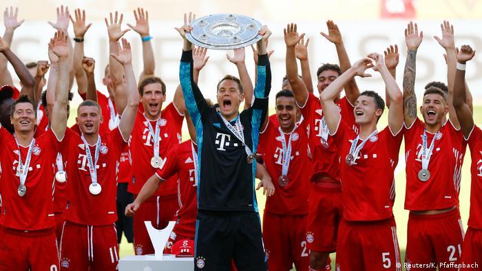 Manuel Neuer lifts the Bundesliga trophy