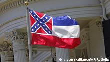 The state flag of Mississippi is unfurled against the front of the Governor's Mansion in Jackson, Miss., Tuesday, June 23, 2015. Republican Lt. Gov. Tate Reeves said Tuesday, that Mississippi voters, not lawmakers, should decide whether to remove the Confederate battle emblem from the state flag. Reeves, who presides over the state Senate, spoke about the issue a day after Republican House Speaker Philip Gunn called the emblem offensive and said the state flag should change. (AP Photo/Rogelio V. Solis) |