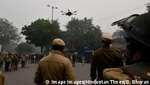 December 19, 2019*** NEW DELHI, INDIA - DECEMBER 19: Rapid Action Force RAF and police personnel launch a drone as people protest against the Citizenship Amendment Act CAA and National Register of Citizens NRC at Red Fort on December 19, 2019 in New Delhi, India. The act seeks to grant Indian citizenship to refugees from Hindu, Christian, Sikh, Buddhist and Parsi communities fleeing religious persecution from Pakistan, Afghanistan, and Bangladesh, and who entered India on or before December 31, 2014. The Parliament had passed the Citizenship Amendment Bill, 2019 last week and it became an act after receiving assent from President Ram Nath Kovind. Since then, protests including some violent ones have erupted in various regions of the country, including the North East over the amended citizenship law. Photo by Biplov Bhuyan/Hindustan Times Protests Ag PUBLICATIONxNOTxINxIND