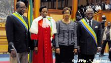 From left to right - Leonard Andjembe, Gabon' Senate vice President, Marie Madeleine Mborantsouo Gabon's Constitutional Court president, newly sworn in Gabon's interim head of state Rose Francine Rogombe, 66, and National assembly President of Gabon Guy Nzouba Ndama pose after Rogombe was sworn in as acting head of state at an official ceremony on June 10, 2009 in Libreville. Africa's longest-serving leader and France's closest ally on the continent, Omar Bongo died on June 8, in a clinic in Spain after more than four decades at the helm of the oil-rich former French colony. Rogombe will have most of the powers of an elected president apart from the authority to dissolve parliament or to hold referendums, officials said. AFP PHOTO/ WILS YANICK MANIENGUI (Photo by WILS YANICK MANIENGUI / AFP)