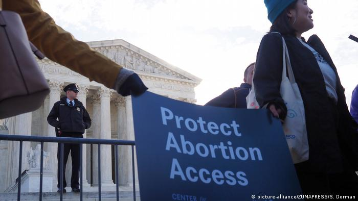 Pro-reproductive rights protesters stand in front of the US Supreme Court