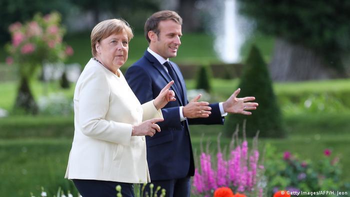 Анґела Меркель та Еммануель Макрон під час зустрічі в палаці Мезеберг