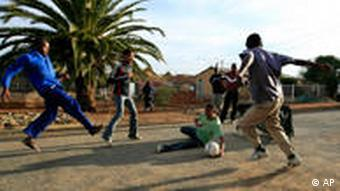 young people playing soccer