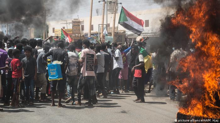 Waving Sudanese flags, protesters gathered in Khartoum and its twin cities Khartoum North and Omdurman
