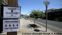 Social distancing signs are posted at one of the bars closed for the next 30 days due to the surge in coronavirus cases Tuesday, June 30, 2020, in Scottsdale, Ariz. (AP Photo/Ross D. Franklin) |