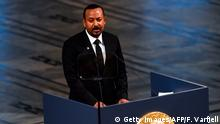 Ethiopia's Prime Minister and Nobel Peace Prize Laureate Abiy Ahmed Ali speaks after receiving the Nobel Peace Prize during a ceremony at the city hall in Oslo on December 10, 2019. - Abiy Ahmed is picking up his Nobel Peace Prize in the Norwegian capital as ethnic violence is on the rise at home, festivities are being kept to the bare minimum and he has refused to speak to the media cancelling this years Nobel Peace Prize press conference. (Photo by Fredrik VARFJELL / AFP) (Photo by FREDRIK VARFJELL/AFP via Getty Images)
