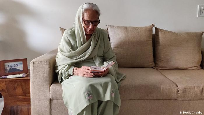 Charanjeet Kaur sits in her living room for her afternoon prayers. Her residential complex has been a containment zone as India struggles to deal with the pandemic