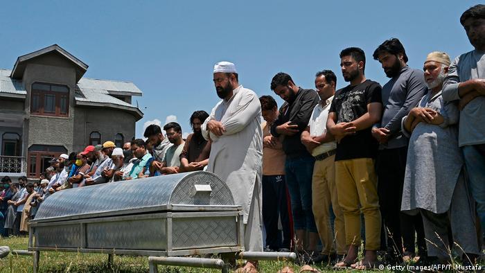 Relatives and neighbors offer prayers at the funeral of Bashir Ahmed Khan (Getty Images/AFP/T. Mustafa)