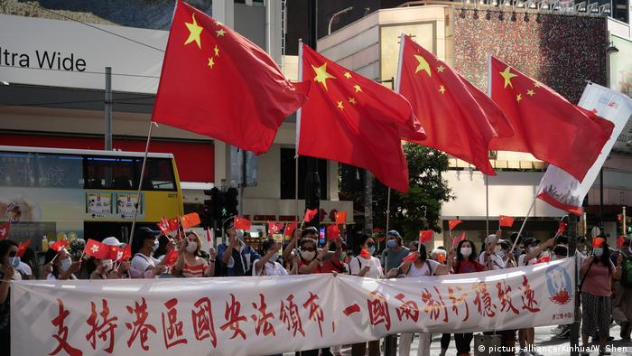 Chinese nationals celebrate the new Hong Kong security law
