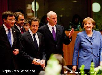 Dutch Prime Minister Jan Peter Balkenende, Spanish Prime Minister Jose Luis Rodriguez Zapatero, France's President Nicolas Sarkozy, Greece's Prime Minister George Papandreou and Germany's Chancellor Angela Merkel arrive at the first working session of the summit