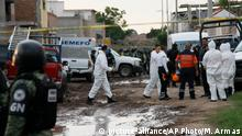 Members of the National Guard and forensic investigators work near a drug rehabilitation center in Irapuato, Mexico, Wednesday, July 1, 2020. At least 24 people were killed in an armed attack on the facility Mexican police said. (AP Photo/Mario Armas)