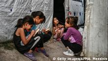 Childs are pictured in a improvised tents camp near the refugee camp of Moria in the island of Lesbos on June 21, 2020. - Greece's announcement that it was extending the coronavirus lockdown at its migrant camps until July 5, cancelling plans to lift the measures on June 22, coincided with World Refugee Day on June 27, 2020. (Photo by ARIS MESSINIS / AFP) (Photo by ARIS MESSINIS/AFP via Getty Images)