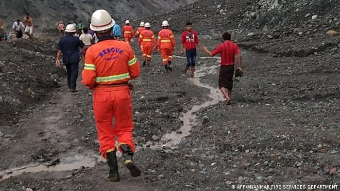 Rescue officials at the site of a mine disaster in Myanmar