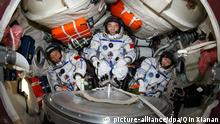 ©ChinaFotoPress/Qin Xianan/MAXPPP - This undated photo shows three taikonauts Jing Haipeng (C), Liu Wang (L) and Liu Yang attending a training in a capsule simulating the re-entry one of the Shenzhou-9 spaceship. They will be carried by the Shenzhou-9 spaceship for China\'s first manned space docking mission with the orbiting Tiangong-1 space lab module. (Photo by Qin Xianan/ChinaFotoPress)***_***429004320 |