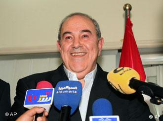Former Iraqi Prime Minister Ayad Allawi speaks to his supporters after the full election results released Friday for Iraq's 325-seat parliament show Allawi winning 91 seats, edging out Prime Minister Nouri al-Maliki's 89 seats in Baghdad, Iraq, Friday, March 26, 2010. (AP Photo/ Khalid Mohammed)
