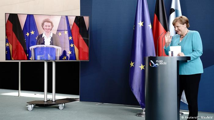 A picture of German Chancellor Angela Merkel and the head of the European Commission, Ursula von der Leyen, during a joint news conference via video conference to mark Germany's taking over the EU's rotating presidency from July 1.
