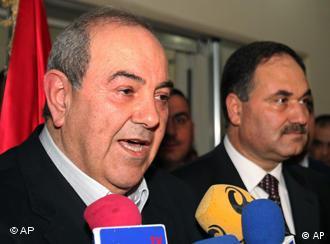 Wahlsieger Allawi (links) sprich zu seinen Anhängern (Foto: AP)
