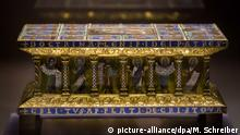 In this picture taken Jan. 9, 2014 the medieval portable altar of Eilbertus a part of the Welfenschatz, is displayed at the Bode Museum in Berlin. One of Germany¿s most precious collections of medieval Christian art is at the center of a complicated ownership dispute between the foundation that oversees the Berlin museums and the heirs of Jewish art dealers who claim their ancestors had to sell the objects to the Nazis under pressure in 1935. For years, both sides have claimed they¿re the legitimate owners, arguing their cases without finding a successful solution, so on Wednesday Jan 15, 2014, in a highly anticipated meeting, a German government-created commission will come together to make a recommendation on who should rightfully own the so-called Welfenschatz -or Guelph Treasure. (AP Photo/Markus Schreiber) |