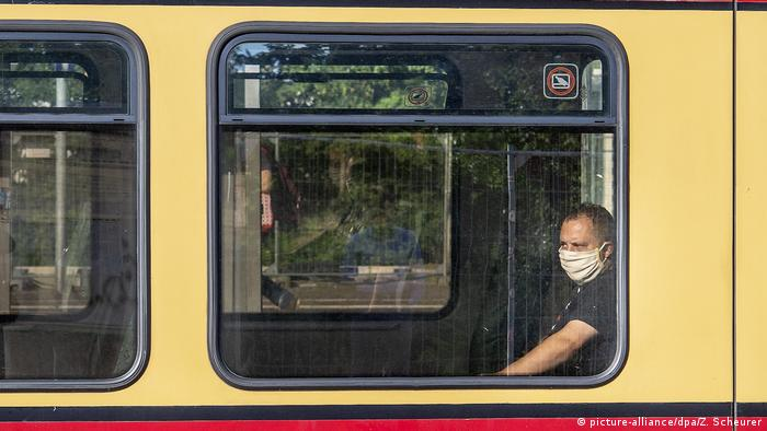 A man wearing a mask on public transport