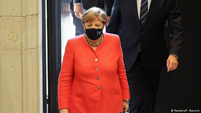 Angela Merkel waring a black face mask