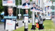 July 2, 2020*** A woman walks by campaign posters in Zagreb on July 2, 2020 ahead of the parliamentary election of July 5. (Photo by Denis LOVROVIC / AFP) (Photo by DENIS LOVROVIC/AFP via Getty Images)
