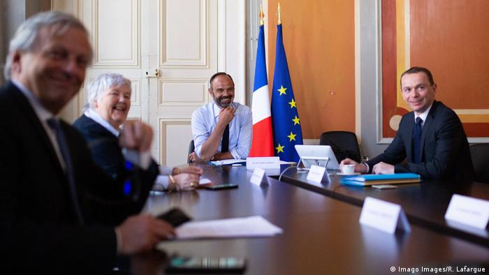 French Prime Minister Edouard Philippe, French Junior Minister for Public Administration Olivier Dussopt and French Minister of Territorial Cohesion and Relations with Territorial Communities Jacqueline Gourault pose prior to taking part in a videoconference meeting