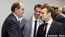 FILE PHOTO: French President Emmanuel Macron shakes hands with Interministerial Delegate for the Olympic and Paralympic Games 2024 Jean Castex (L) flanked by President of the Paris Organising Committee of the 2024 Olympic and Paralympic Games Tony Estanguet during the inauguration of a new handball complex in Creteil, on the outskirts of Paris, France January 9, 2019. Ludovic Marin/Pool via REUTERS/File Photo