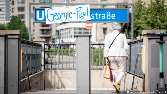 A George Floyd sign covers the name of the Mohrenstraße underground station in Berlin, Germany