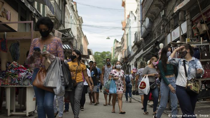 Street in Rio de Janeiro with people wearing face masks