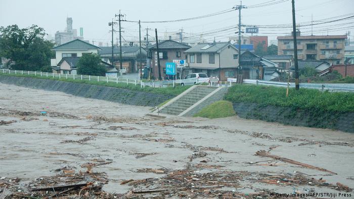 Rising water caused by heavy rain is seen at Kuma river in Yatsushiro, Kumamoto prefecture