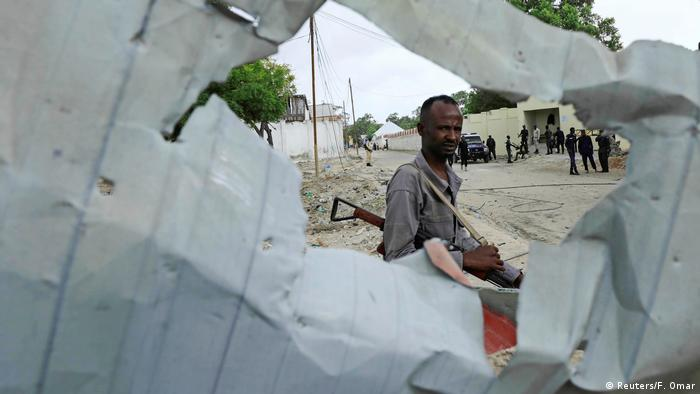 An armed Somali watches after an attack by al-Shabab