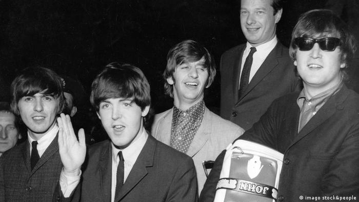 The Beatles in 1964 with their manager Brian Epstein