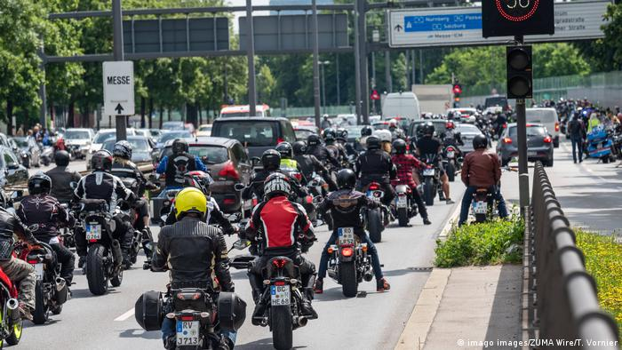 Motorcyclists protest in a convoy through the streets of Munich
