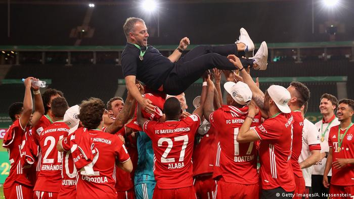 Hansi Flick is held aloft by Bayern Munich's players (Getty Images/A. Hassenstein)