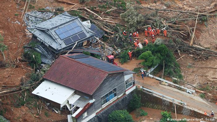 Two houses are destroyed by a landslide