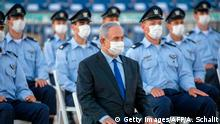 Israeli Prime Minister Benjamin Netanyahu (C), clad in mask due to the COVID-19 coronavirus pandemic, attends a graduation ceremony for new pilots in Hatzerim air force base near the southern Israeli city of Beersheba, on June 25, 2020. (Getty Images/AFP/A. Schalit)