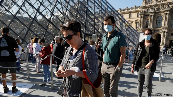 Visitors queue in front of the Louvre Pyramid, Paris, France(Reuters/C. Platiau)