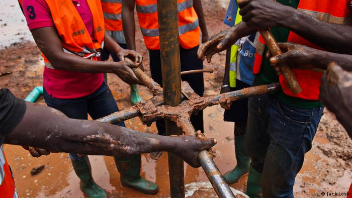 A team of former child soldiers finish drilling their new well in Bangui (Jack Losh)