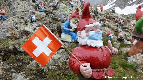 Gnomes in the Swiss Alps wearing surgical masks