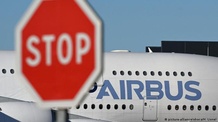 A parked Airbus A380 pictured in Toulouse, France, on July 5th, 2020. A large red STOP sign is in the foreground. (picture-alliance/abaca/H. Lionel)