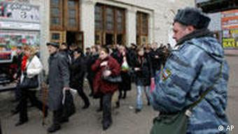 Police officers evacuate people from Park Kultury (Park of Culture) subway station in downtown Moscow