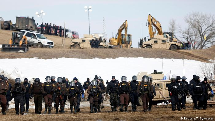 Law enforcement officers advance into the main opposition camp against the Dakota Access oil pipeline near Cannon Ball, North Dakota, U.S., February 23, 2017. (Reuters/T. Sylvester)