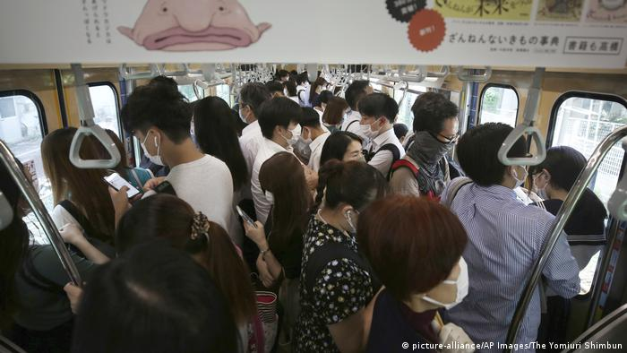 Inside a Japanese train packed with passengers during a rush hour in Tokyo
