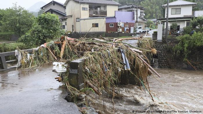 A bridge is closed due to a flooding of Nogami river in Kokonoe town, Oita Prefecture on July 7, 2020