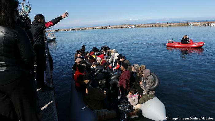 A boat full of refugees from Turkey is turned way by local people at the port of Thermi, on the island of Lesvos, Greece
