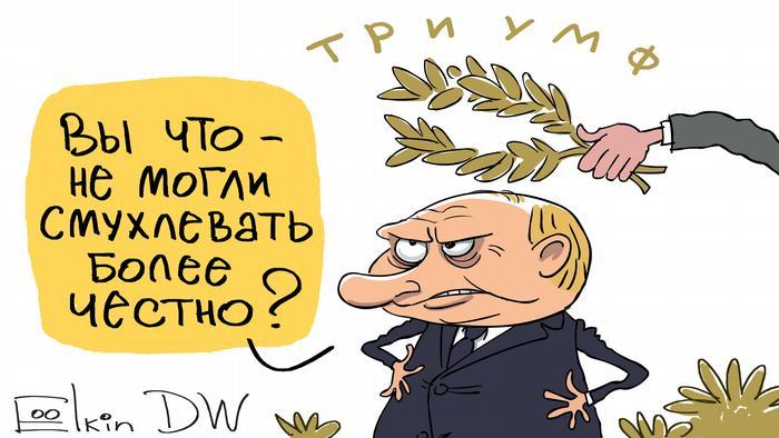 На Путина надевают венок, над которым написано триумф