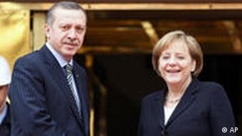Chancellor Angela Merkel shakes hands with Prime Minister Erdogan