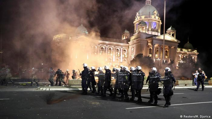 Riot police during overnight protests in Belgrade