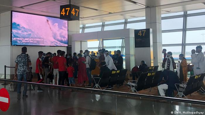 At the boarding gate, people rushed to board the flight, ignoring pleas from airline personnel to maintain social distancing.